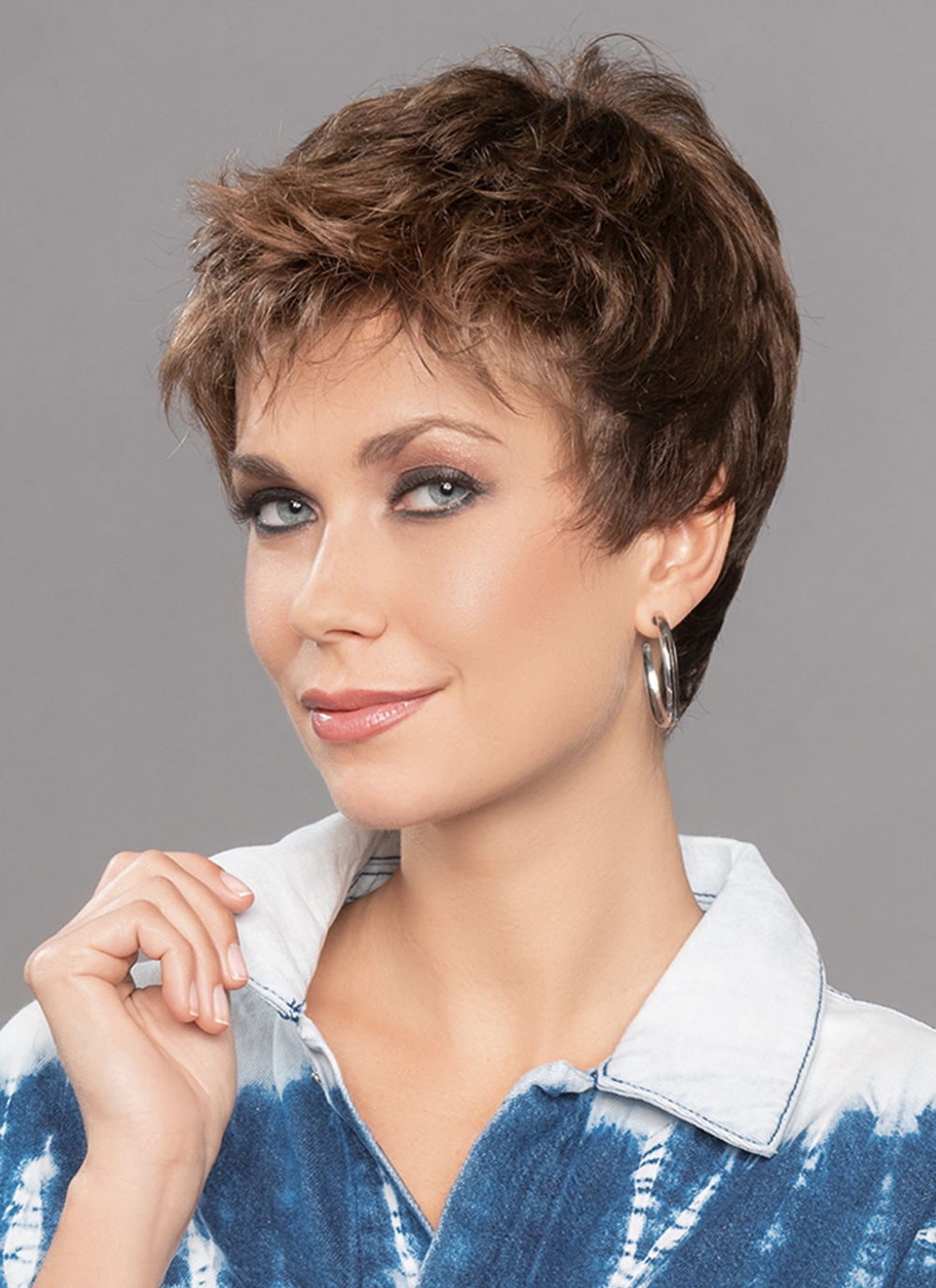 Tab Wig by Ellen Wille | The synthetic strands of this wig can be worn brushed off of the face thanks to a lace front wig cap that creates a natural looking hair line