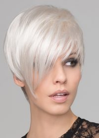 This short, asymmetrical boy cut is soft, with a tapered neckline and angled fringe