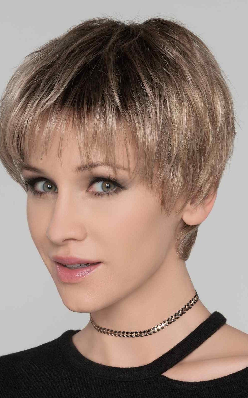 Stop Hi Tec   his look can be easily finger styled to fit a host of different looks. The monofilament top allows the longer front strands to be parted to the left, the right, or in the center.