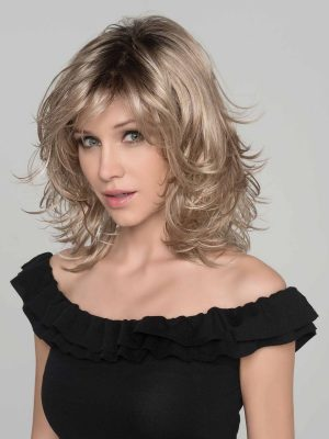 The Ocean wig by Ellen Wille is a beautiful mid-length style wig with light waves. It is shown in sandy blonde rooted.