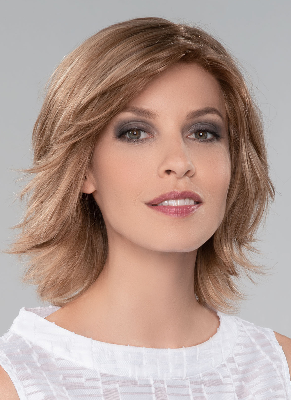 Sole | A hand-tied monofilament top, a beautiful lace front hairline gives the appearance of a natural look and to offer styling options.
