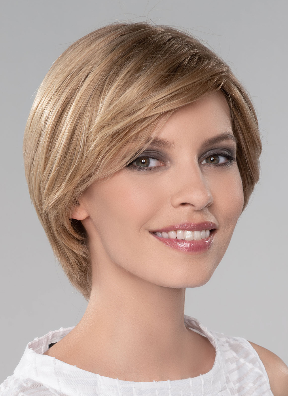 Dia | A hand-tied monofilament top and a 100% hand-tied cap create ample styling options, as well as gives the appearance of natural hair growth from the scalp.